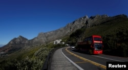 A tour bus carries visitors to Table Mountain in Cape Town, South Africa, August 5, 2017.