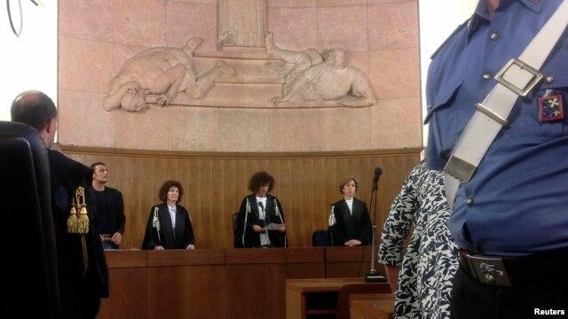 President of the court Giulia Turri (C) reads the sentence for former Italian prime minister Silvio Berlusconi in Milan, June 24, 2013.