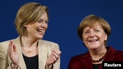 German Chancellor Angela Merkel, right, and Christian Democratic Union deputy head Julia Kloeckner attend a CDU campaign rally in Landau, Germany, Feb. 22, 2016. Worldwide last year, the number of women parliamentarians increased by a slight 0.5 percent in 58 national elections.