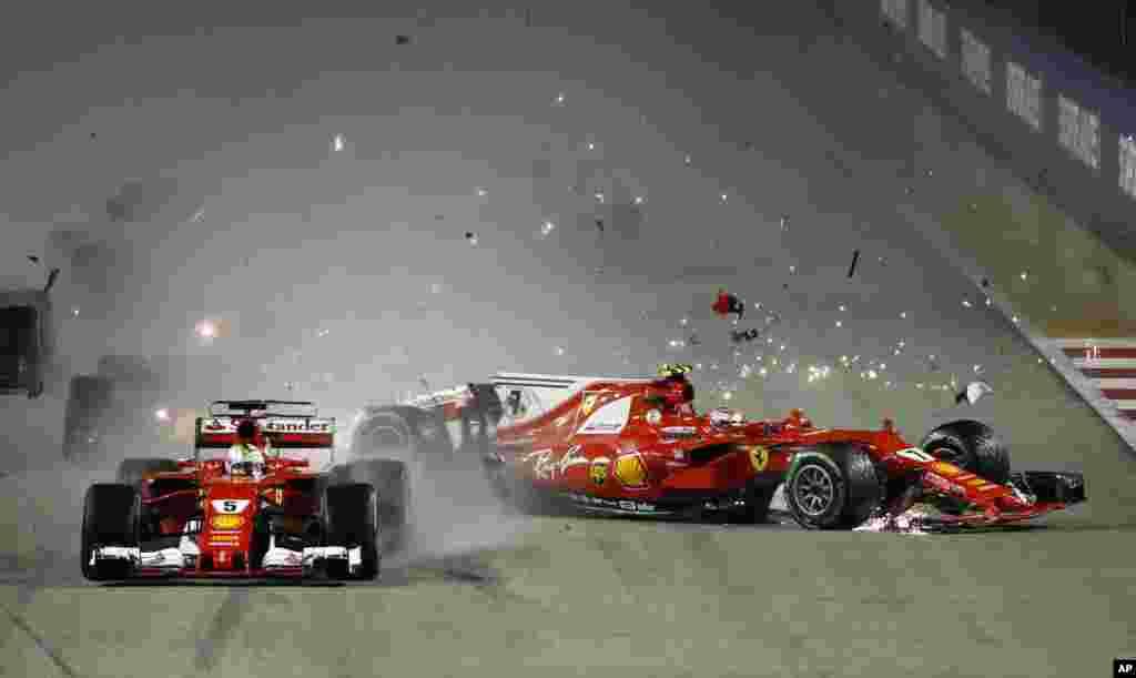 싱가포르 마리나베이 시티서킷에서 열린 '싱가포르 포뮬러원 그랑프리' 자동차 경주대회에서 페라리 소속 핀란드의 키미 라이코넨이 운전하는 차가 같은 팀 독일의 세바스티안 베텔이 운전하는 차와 충돌했다.