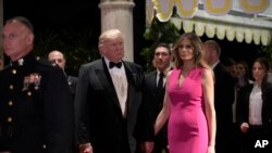 President Donald Trump and first lady Melania Trump arrive for the 60th annual Red Cross Gala at Trump's Mar-a-Lago resort in Palm Beach, Florida, Feb. 4, 2017. Fueled by Trump's controversial immigration orders, activists are calling for charities to move or cancel planned galas at the resort.