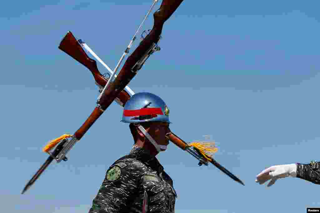 Honor guards perform during a military drill at the naval base in Kaohsiung, Taiwan.