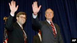 FILE - In this Nov. 26, 1991, photo, President George H.W Bush, right, and William Barr wave after Barr was sworn in as the new attorney general of the United States in Washington. President Donald Trump said Friday he would nominate Barr to serve in the