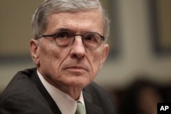 "FILE - FCC Chairman Tom Wheeler is shown giving testimony on Capitol Hill, March 17, 2015. Wheeler says the net neutrality ruling ensures the internet will remain ""a platform for unparalleled innovation, free expression and economic growth."""