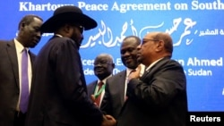 South Sudan President Salva Kiir, Sudan's President Omar Al-Bashir and South Sudan rebel leader Riek Machar talk after signing a peace agreement aimed to end a war in which tens of thousands of people have been killed, in Khartoum, Sudan, June 27, 2018.