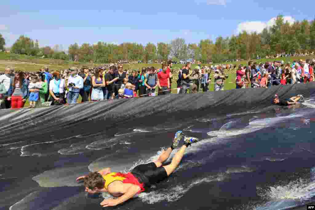 Participants compete in the second edition of the Spartacus survival run in Boom, Belgium.