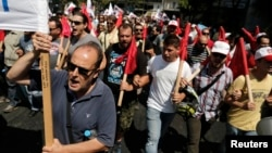 Supporters of the Communist-affiliated trade union PAME take part in an anti-austerity rally during a 24-hour general strike, in Athens, July, 16, 2013.