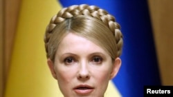 FILE - Ukraine's Prime Minister and presidential candidate Yulia Tymoshenko chairs a cabinet meeting in Kiev, February 11, 2010.