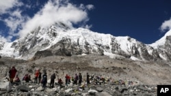 In this 2015 file photo, hikers rest at Mount Everest Base Camp in Nepal. Many goals, like climbing a mountain, require hard work, planning and many small steps to achieve. (AP Photo/Tashi Sherpa, file)