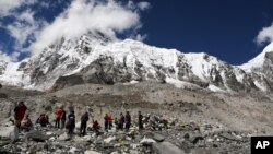 Trekkers rest at Mount Everest Base Camp, Nepal.