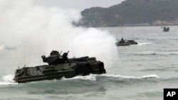 Amphibious assault vehicles prepare to hit the ground at a join military exercise, 'Cobra Gold' on Hat Yao beach in Chonburi province eastern, Thailand, February 10, 2012.