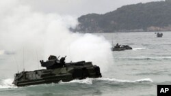 FILE - Amphibious assault vehicles prepare to hit the ground at joint military exercise 'Cobra Gold' on Hat Yao beach in Chonburi province, eastern Thailand, February 10, 2012.