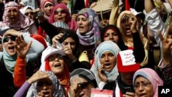 Egyptian women chant slogans as they attend a demonstration in Tahrir Square in Cairo, Egypt, April 1, 2011.