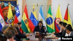 Venezuela's President Nicolas Maduro speaks to the Union of South American Nations' (UNASUR) foreign ministers at Miraflores palace in Caracas, March 25, 2014