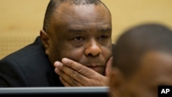 Former Congo vice-president Jean-Pierre Bemba looks up at his trial at the International Criminal Court in The Hague, Netherlands, Sept. 29, 2015.