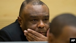 FILE - Former Congo vice-president Jean-Pierre Bemba looks up at his trial at the International Criminal Court in The Hague, Netherlands, Sept. 29, 2015.