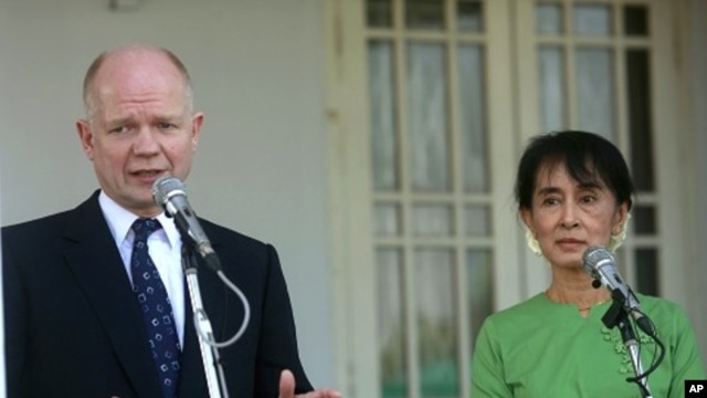Britain's Foreign Secretary William Hague talks to reporters after meeting with Myanmar pro-democracy leader Aung San Suu Kyi at her home in Rangoon January 6, 2012