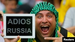A spectator holds up a message for Russia before the start of the 2014 World Cup Group H soccer match against Belgium at the Maracana stadium in Rio de Janeiro June 22, 2014.