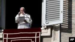 Pope Francis gestures during the Angelus noon prayer in St. Peter's Square at the Vatican, Dec. 17, 2017.