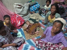 IDPs from different villages have become new neighbors in their camp, Laiza, Burma, August 2011