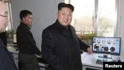FILE - The United States says North Koreans' Internet access has been limited under Kim Jung Un, shown at a cartoon studio in an undated photograph released by North Korea's official news agency KCNA in November 2014.