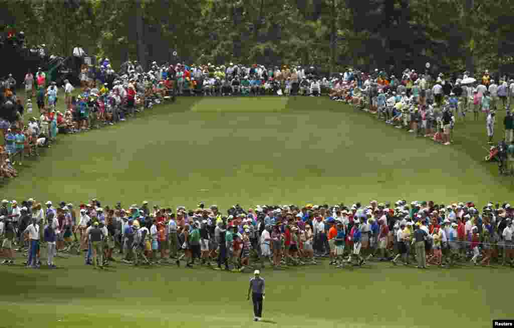 Jordan Spieth of the U.S. walks up the eighth fairway during second round play of the Masters golf tournament at the Augusta National Golf Course in Augusta, Georgia.