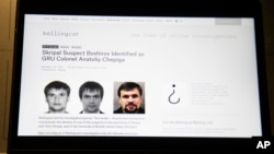 The website of the British investigative group Bellingcat showing alleged photos of Col. Anatoliy Chepiga is seen on a computer screen in Moscow, Russia, Sept. 27, 2018.