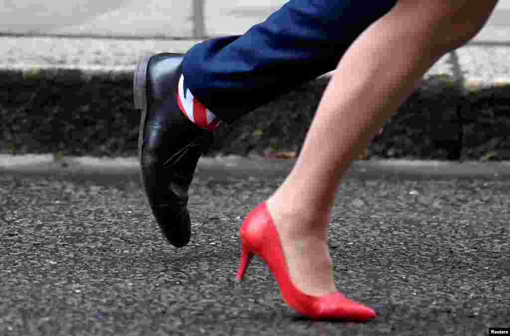 Britain's Health and Social Care Secretary Matt Hancock wears Union Jack socks as he leaves with Leader of the House of Lords Baroness Evans after a cabinet meeting on Downing Street in London.