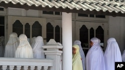 Members of the Ahmadiyah community attend Friday prayers at the An-Nur Mosque in Manis Lor village, in Kuningan, West Java. Indonesian Foreign Minister Marty Natalegawa defended the country's judicial system after a court sentenced Muslim radicals to a fe