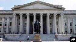 FILE - A statue of former Treasury Secretary Albert Gallatin is seen outside the Treasury Building in Washington, DC.