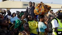 In this image taken May 23, 2015, refugees who fled Burundi's violence and political tension arrive in Kigoma, Tanzania, after making the journey on Lake Tanganyika.