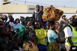 FILE - In this image taken May 23, 2015, refugees who fled Burundi arrive in Kigoma, Tanzania, after making the journey on Lake Tanganyika.