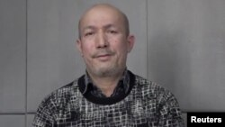 FILE - A man who identifies himself as Uighur poet and musician Abdurehim Heyit is seen in this still image taken from a video posted online by China Radio International's Turkish language service on Feb. 10, 2019.