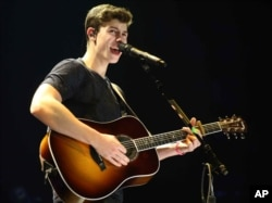 Shawn Mendes performs as the opener for Taylor Swift during The 1989 World Tour at the Georgia Dome on October 24, 2015, in Atlanta.