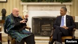 Presiden AS Barack Obama menerima kunjungan Presiden Afghanistan Hamid Karzai di Gedung Putih, Jumat (11/1).