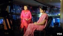 Barkha Dutt, (in red dress) Group Editor, NDTV. (Photo: Deepak Dobhal / VOA)