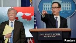 Міністр фінансів США Стівен Мнучин та радник з національної безпеки США Джон Болтон оголошують нові санкції США стосовно Венесуели, 28 січня 2019 року