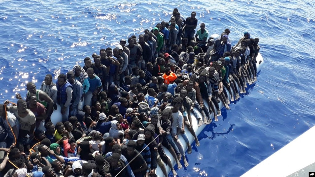 This Sunday, June 24, 2018 photo released by the Libyan Coast Guard shows migrants on a ship intercepted offshore near the town of Gohneima, east of the capital, Tripoli.
