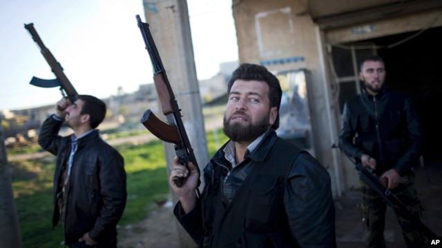 FILE - Free Syrian Army fighters look at a Syrian Army jet, not pictured, in Fafeen village, north of Aleppo province, Syria. A spokesman for the High Negotiations Committee said representatives plan to start arriving in Geneva on Friday.