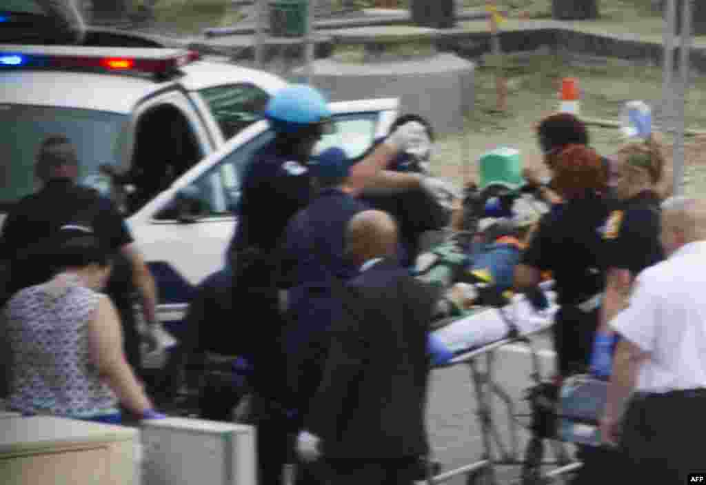 Capitol Police and medics take a shooting victim away on a stretcher at the site of a shooting on Capitol Hill.
