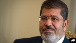 Mohammed Morsi sitting in Ittihadiya Palace, the official residence of the president, in Heliopolis, a suburb of Cairo (photo from 10/07/12).