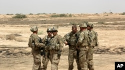 Bag'dodda xizmat qilayotgan amerikalik askarlar. 27-may, 2015-yil.