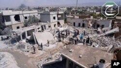 Nhà cửa ở thị trấn Qusair, Homs, bị phá hủy trong một cuộc oanh kích của quân đội chính phủ Syria, ngày 21/5/2013.