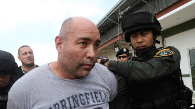 Joseph Manuel Hunter is led by Thai police commandos to Police Aviation Division after being arrested, Sept. 26, 2013.