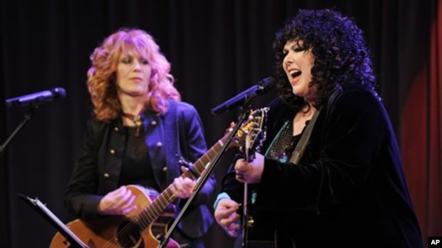 Nancy Wilson, left, and her sister Ann of the band Heart