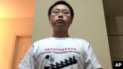 "University of Georgia graduate student, Gu Yi poses for a self-portrait wearing a T-shirt with the words ""Support Tiananmen Mothers"" at his home in Athens, Georgia. Mr. Gu is author of an open letter calling for his compatriots to learn more about the Tiananmen crackdown 26 years ago."