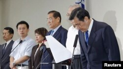 Tổng thống Đài Loan Mã Anh Cửu tại một cuộc họp báo ở Đài Bắc sau khi bị đánh bại trong cuộc bầu cử địa phương, 29/11/14