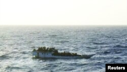 A picture released by the Australian Maritime and Safety Authority (AMSA) shows a boat which according to the AMSA was taken mid-morning before the boat sank near Christmas Island June 27, 2012.