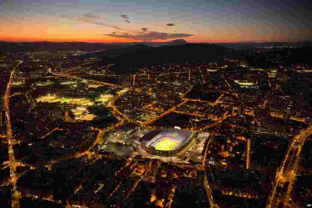 The Camp Nou stadium is illuminated ahead of a soccer match between Barcelona F.C and Eibar in Barcelona, Spain, Sept. 19, 2017.