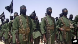 Al-Shabab fighters on parade with their guns during military exercises on the outskirts of Mogadishu,Somalia (File Photo - February 17, 2011)